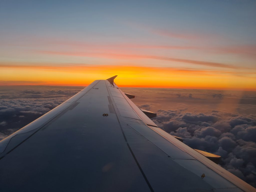 Sunset with wing of plane