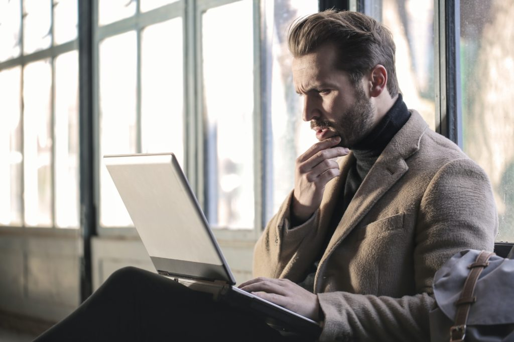 Confused man at laptop