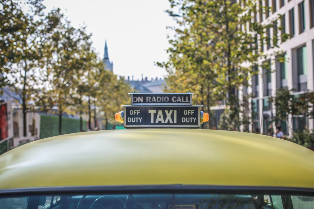 Yellow taxi sign on duty