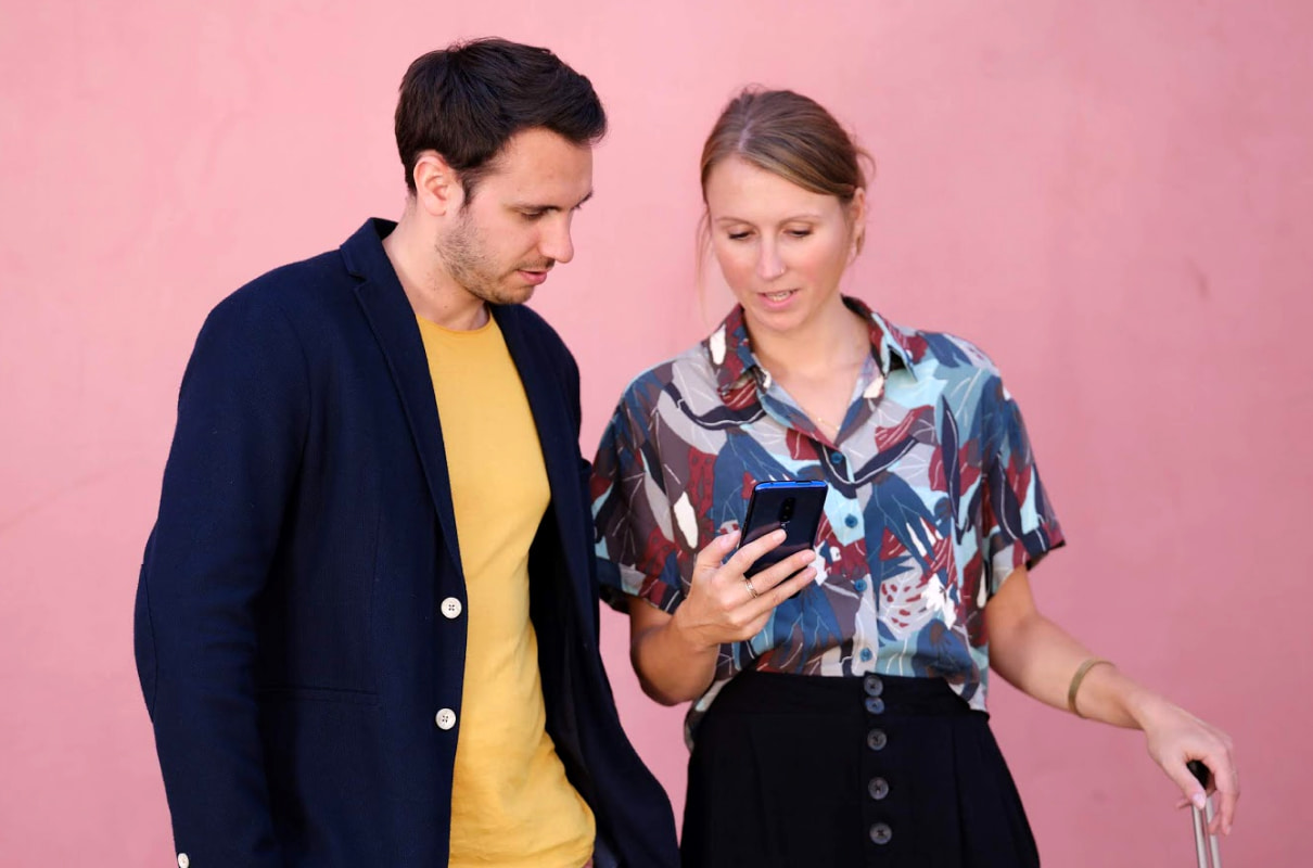Two people looking at phone