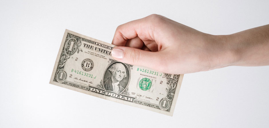 hand holding one dollar