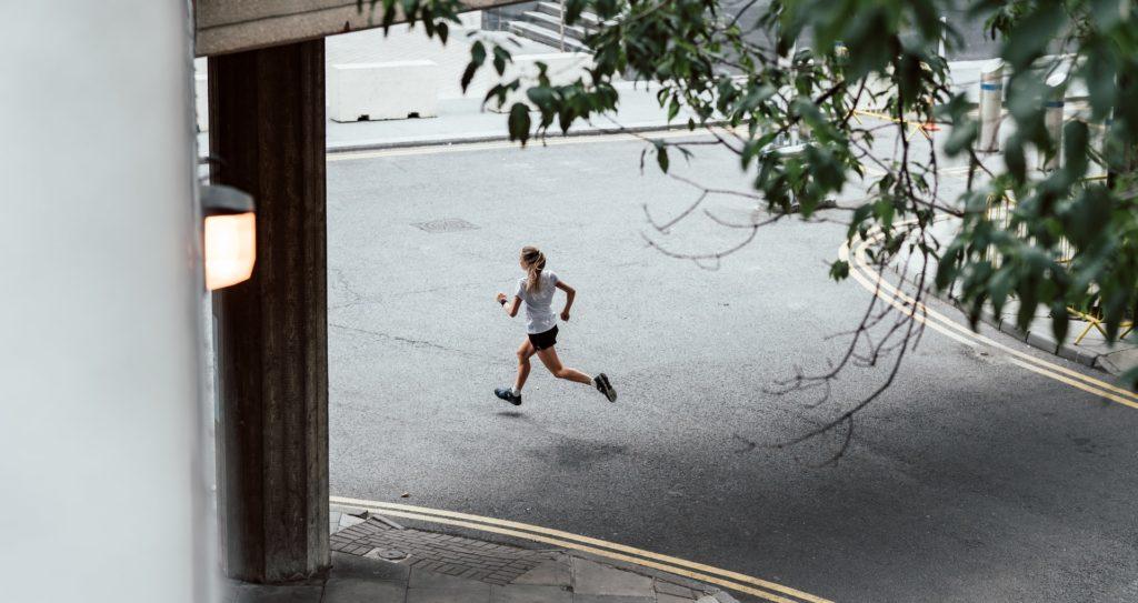 Woman running through city