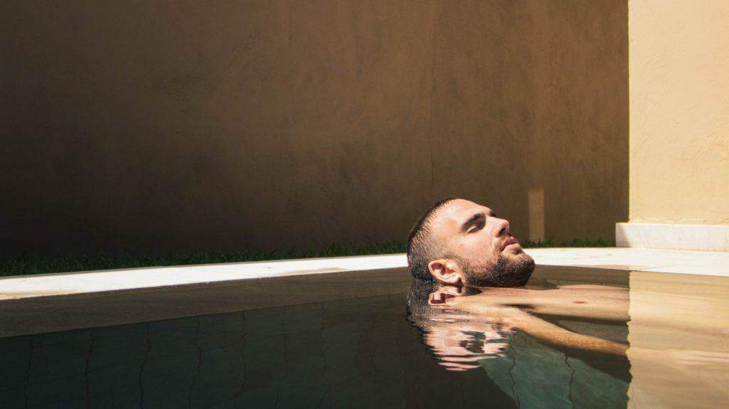 Man relaxing in spa pool