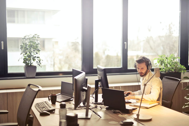 man at the office with headphones