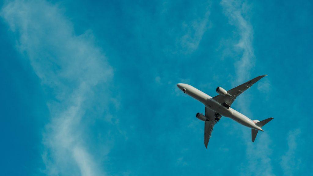 Airplane flying blue sky