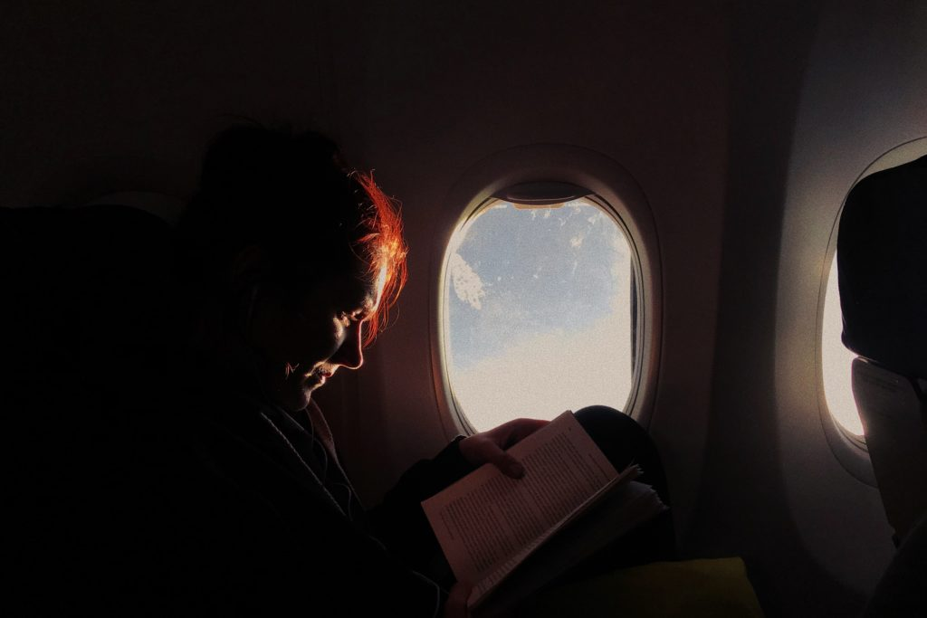 Woman reading on the plane