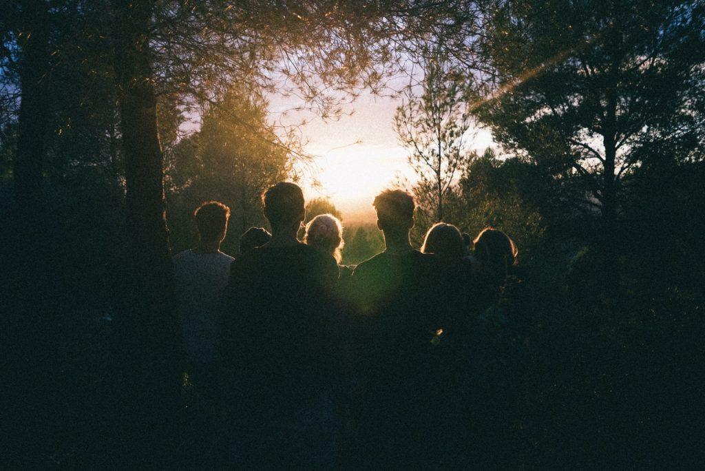 Team together at sunset