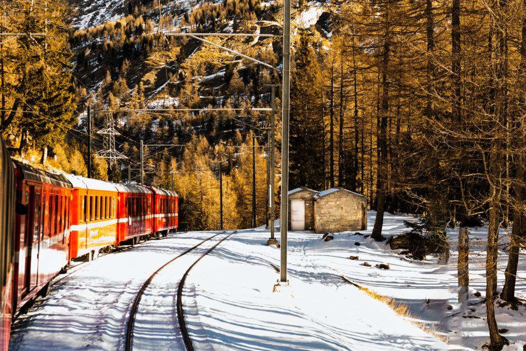 Train on tracks through the snow