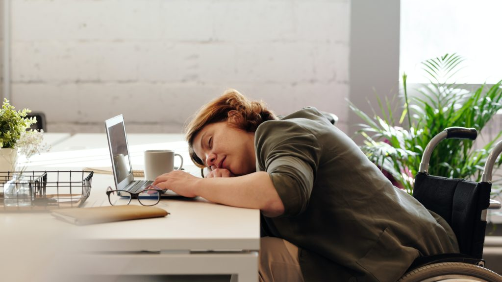 Woman asleep at work