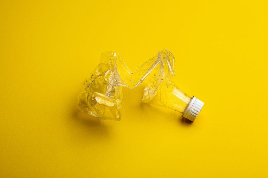 Plastic bottle yellow background